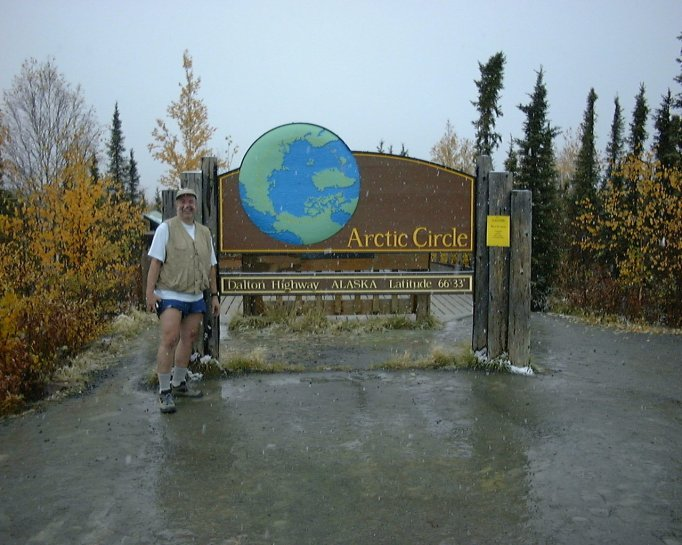 In September of 2000 a buddy and me finally made the Arctic Circle.  Of course we had to do the 'touristy shot'; that yellow placard on the sign post is warning of a habituated grizzly in the area..we didn't see it.