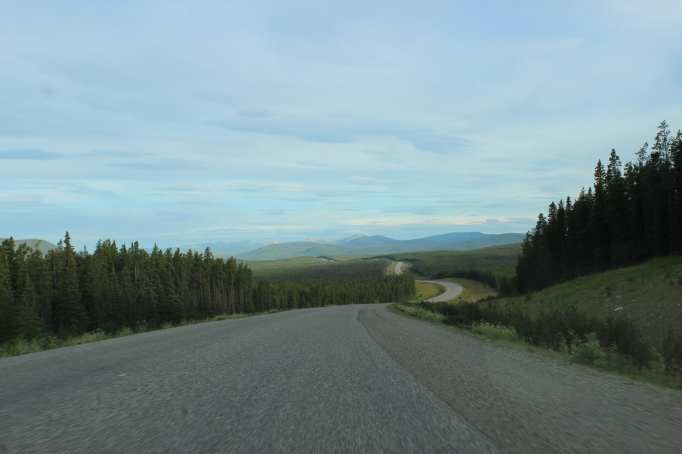 Rarely is the Alaska Highway straight and level; this image shows what is much more 'typical' of the drive