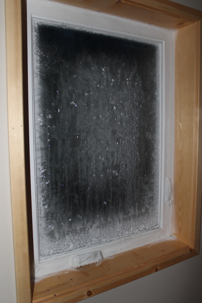 The result of closing off the NE bedroom on the second floor and an outside temp that never reach 0 F for two days and dropped to -23 F at night.  The ice in the corner was 0.6 inches (15.24 mm) thick!