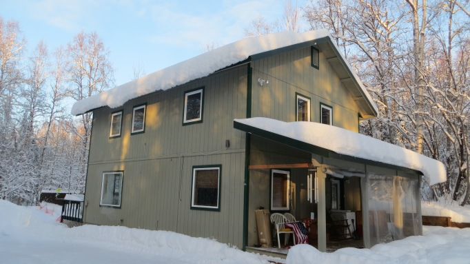 Sunday morning sunlight on the snow covered roof of my place