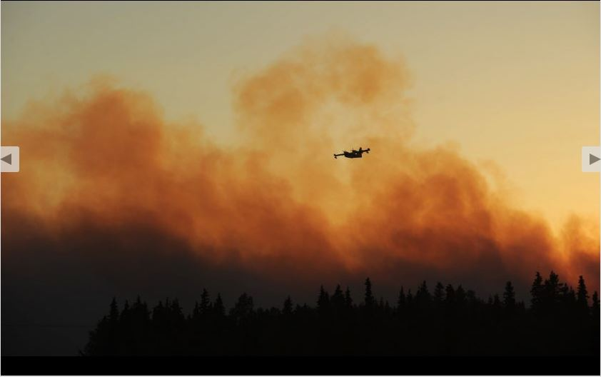 Water tanker aircraft makes a run on the Sockeye Wildfire around Willow